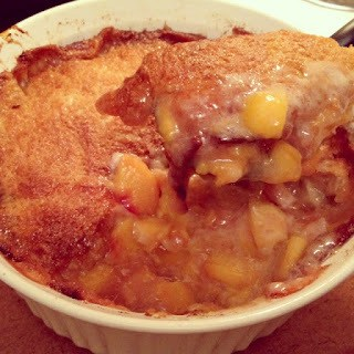 Homemade prize peach cobbler in a baking dish