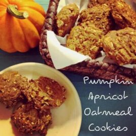 A basket and plate full of pumpkin apricot oatmeal cookies