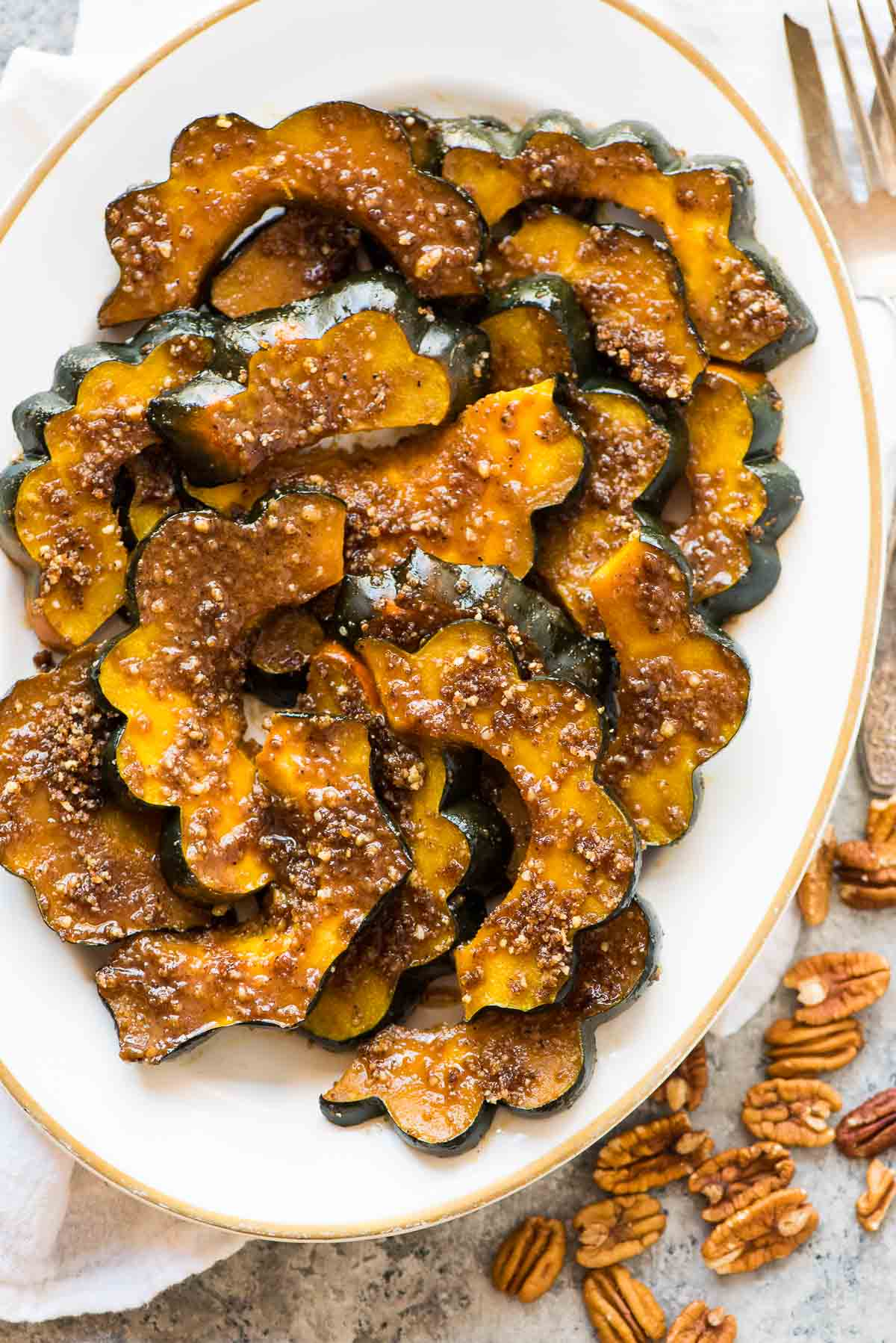 Baked Acorn Squash Slices with Brown Sugar and Pecans. A few simple ingredients and 30 minutes are all you need to make this delicious recipe! Perfect holiday recipe or anytime you need an easy side. Recipe at wellplated.com | @wellplated