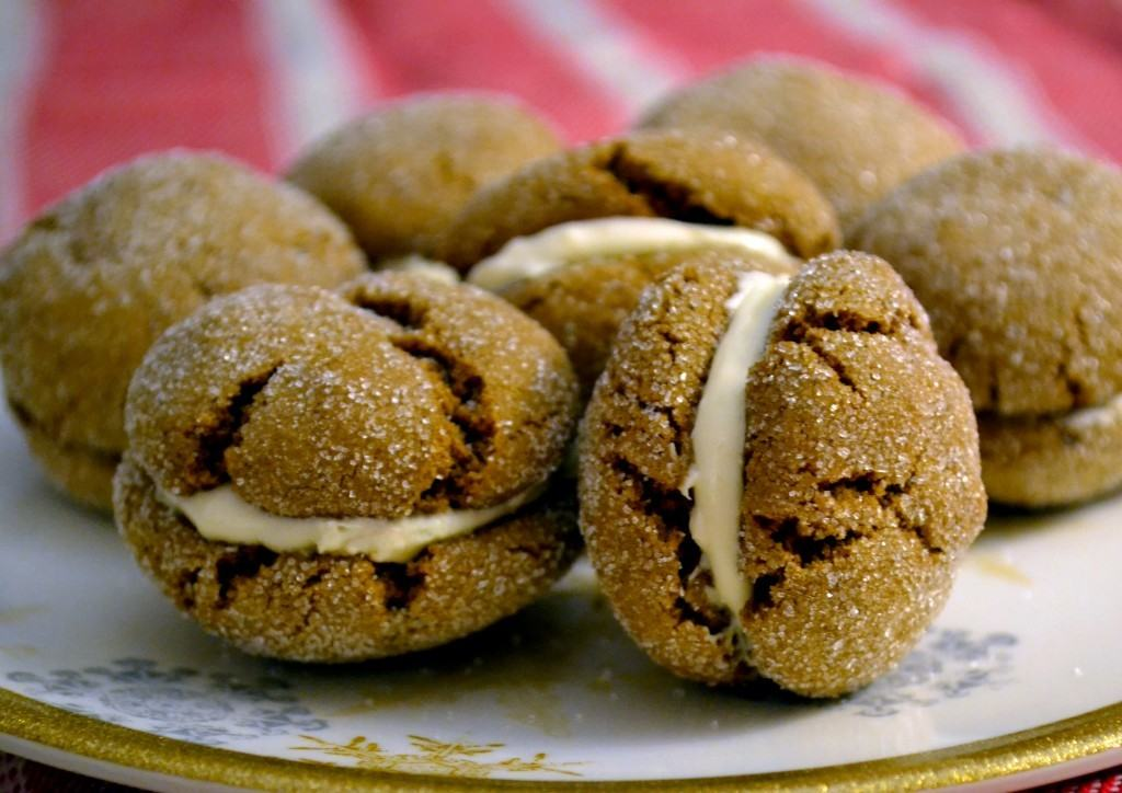 Ginger molasses cookies with maple cream filling on a plate