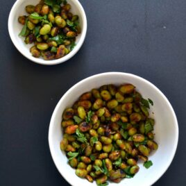 Two bowls full of Thai spice crispy edamame