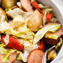 A plate of slow cooker Irish potatoes, turkey sausage, and cabbage