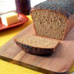 A slice removed from a loaf of magic multigrain whole wheat sandwich bread
