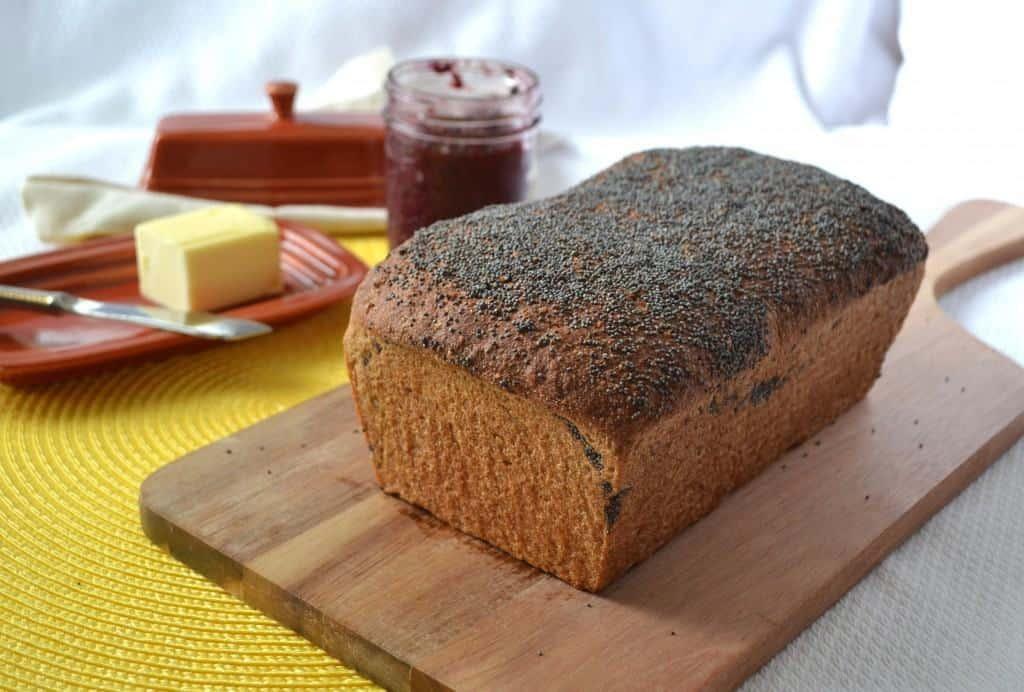 A loaf of magic whole wheat sandwich bread on a wooden board
