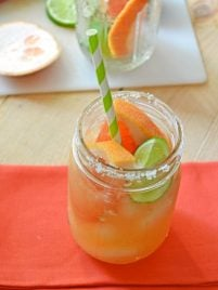 A delicious chipotle grapefruit margarita with sliced fruit
