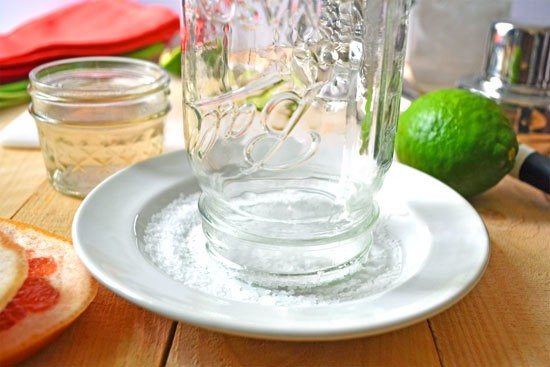 The rim of a jar being salted for margaritas