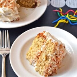 A slice of fluffy banana cake with toasted coconut frosting