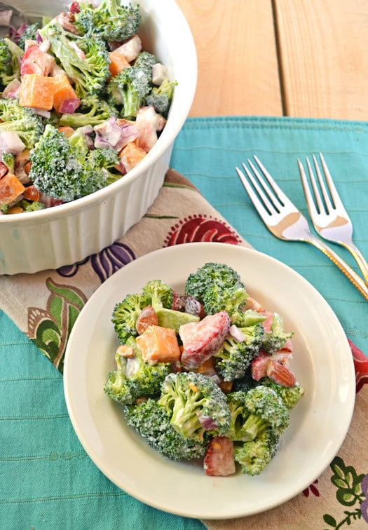 Strawberry broccoli salad served on a white plate