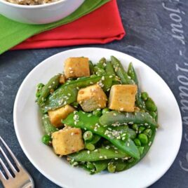 Easy ginger tofu stir fry recipe on a white plate