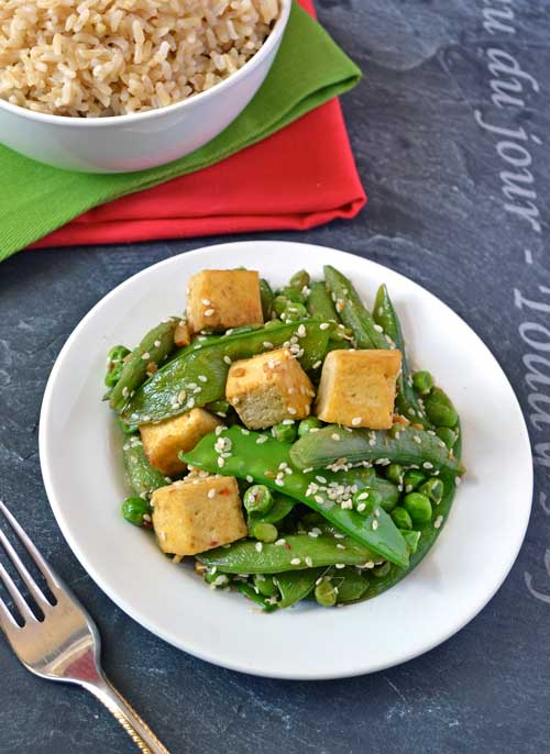 Three pea ginger tofu stir fry on a white plate