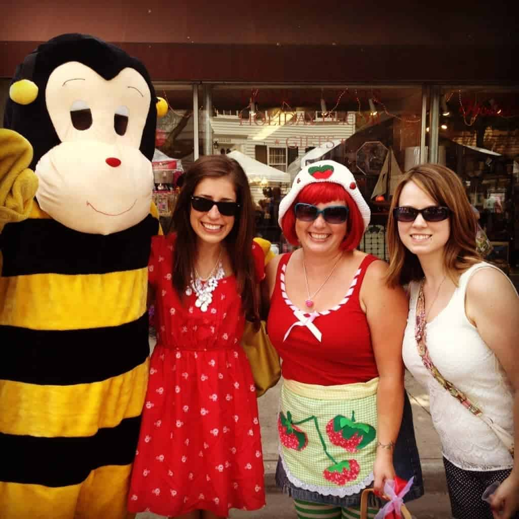 Erin Clarke standing with two women and someone dressed as a bee