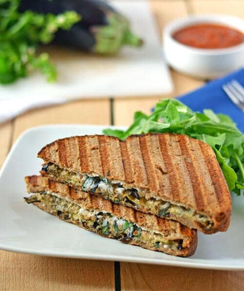 Eggplant Ricotta Grilled Cheese on a white plate with arugula