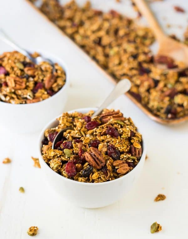 Easy and healthy homemade pumpkin granola with oats, quinoa, pecans, and maple syrup. Recipe at wellplated.com