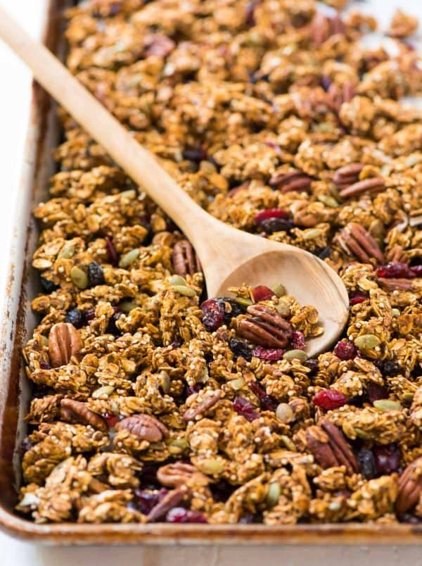 Pumpkin Quinoa Granola. Sweet and crunchy with all the flavors of fall! Easy, gluten free recipe. Recipe at wellplated.com