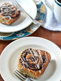Two plates with chai cinnamon rolls