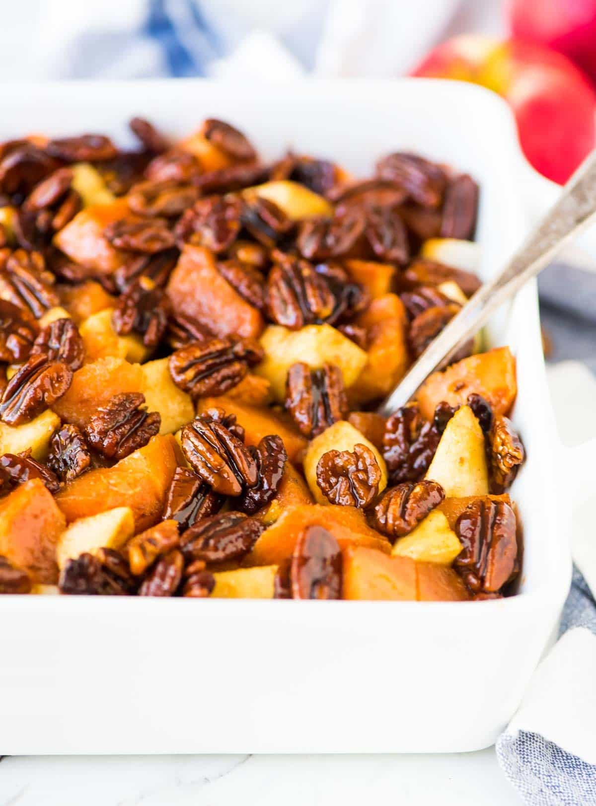 Cinnamon Glazed Sweet Potatoes with Whiskey Pecans and Apples. The perfect Thanksgiving side dish recipe and holiday recipe! Recipe at wellplated.com | @wellplated