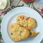 Two heart-shaped strawberry scones on a white plate