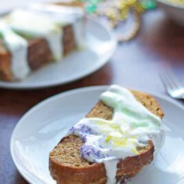 Mardi Gras king cake on a plate