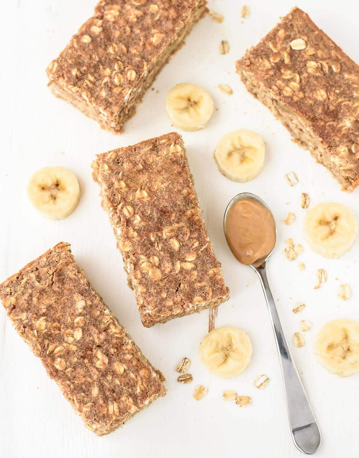 4 Peanut Butter and Honey Oatmeal Breakfast Bars on a white countertop