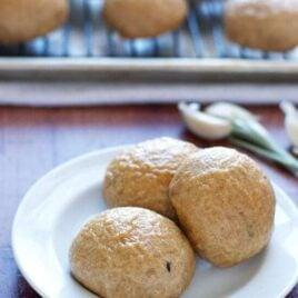 Roasted garlic potato rolls on a white plate
