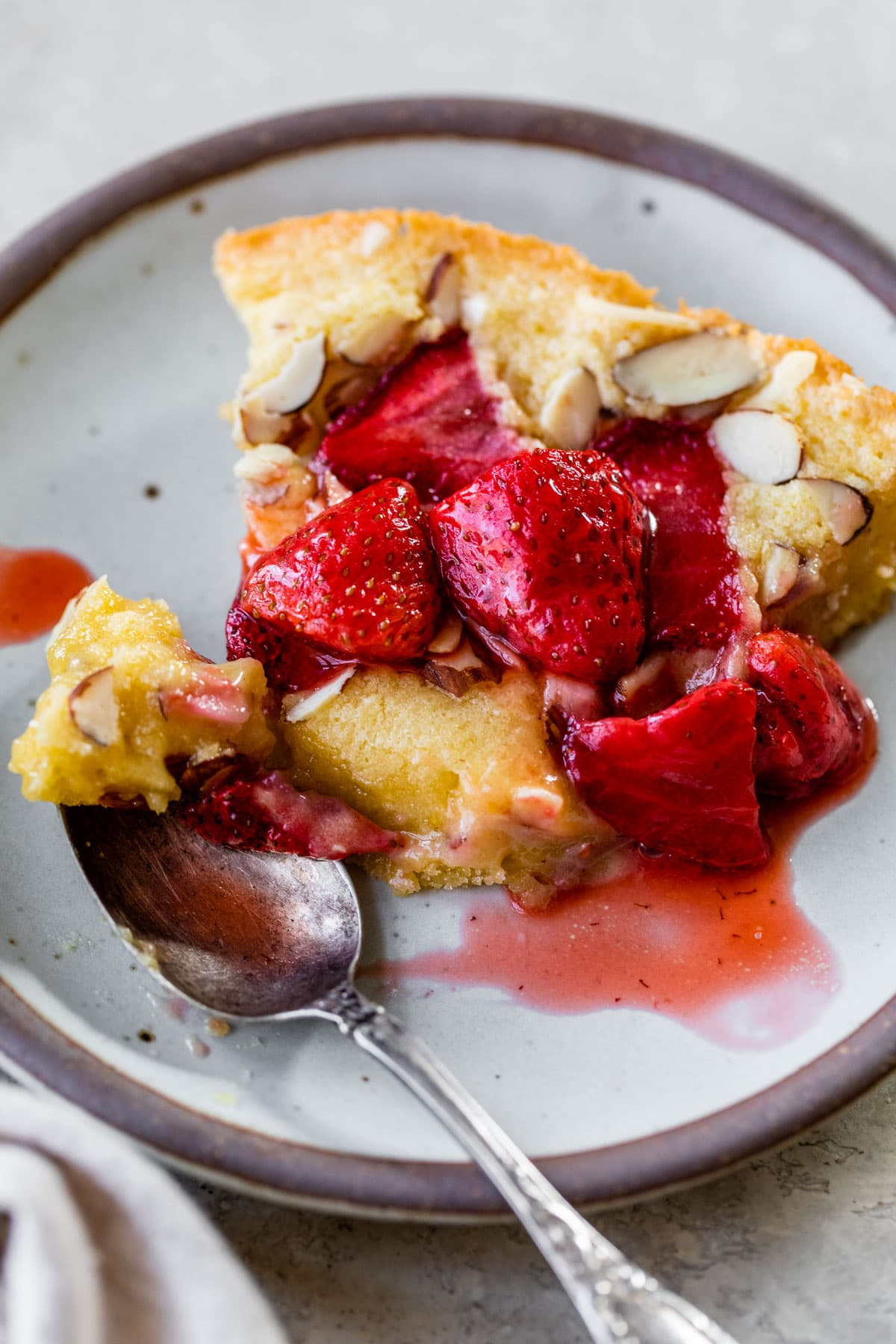 Strawberry Almond Skillet Cake. Super moist almond cake baked in a skillet and topped with roasted strawberries.