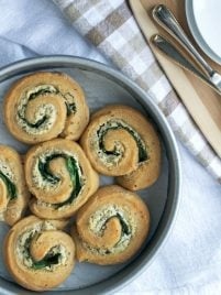Spinach and goat cheese rolls on a plate