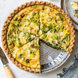 Sunburst Spring vegetable quiche with puff pastry crust on a cutting board