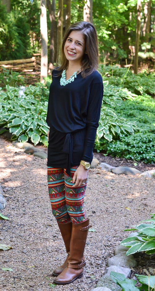 Bolded printed leggings and black tunic with books