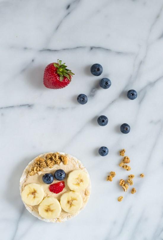Healthy Peanut Butter Yogurt Fruit Pizza-Rice cakes topped with honey peanut butter yogurt dip and fresh fruit