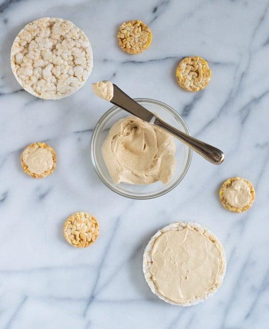 Healthy Peanut Butter Yogurt Fruit Pizza-Spread rice cakes with honey peanut butter yogurt dip and top with fresh fruit