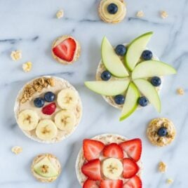 "Healthy Peanut Butter Yogurt Fruit Pizzas. Rice cakes spread with peanut butter ""sauce"" and topped with fresh fruit. Kids love this after school snack!"