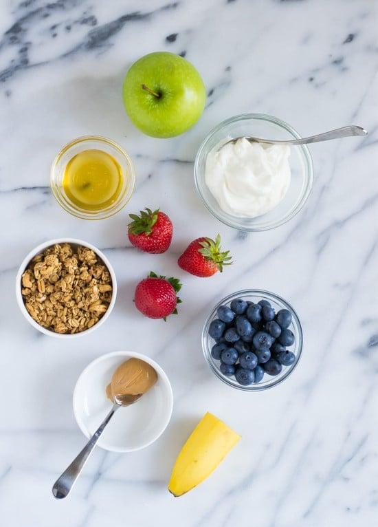 Healthy Peanut Butter Yogurt Fruit Pizzas-Rice cakes topped with a honey peanut butter yogurt sauce and fresh fruit