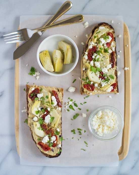 Sundried Tomato, Artichoke and Hummus Tartines - Toasted bread topped with hummus, sundried tomatoes, and feta. My favorite easy, healthy lunch