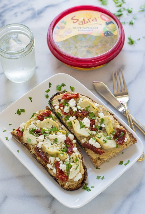 Sundried Tomato, Artichoke and Hummus Tartines - Toasted bread topped with hummus, sundried tomatoes, and feta. SO GOOD!