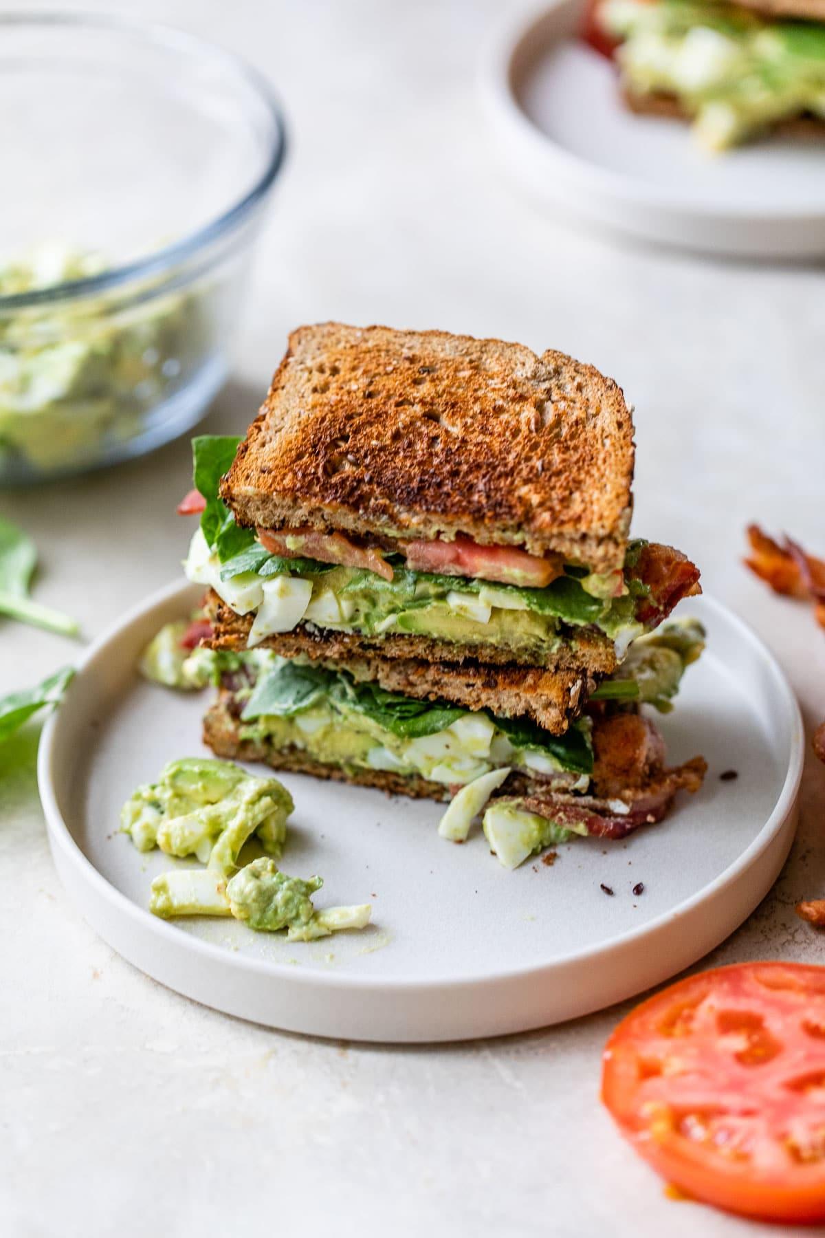 Avocado Egg Salad Bacon Sandwiches on toasted bread
