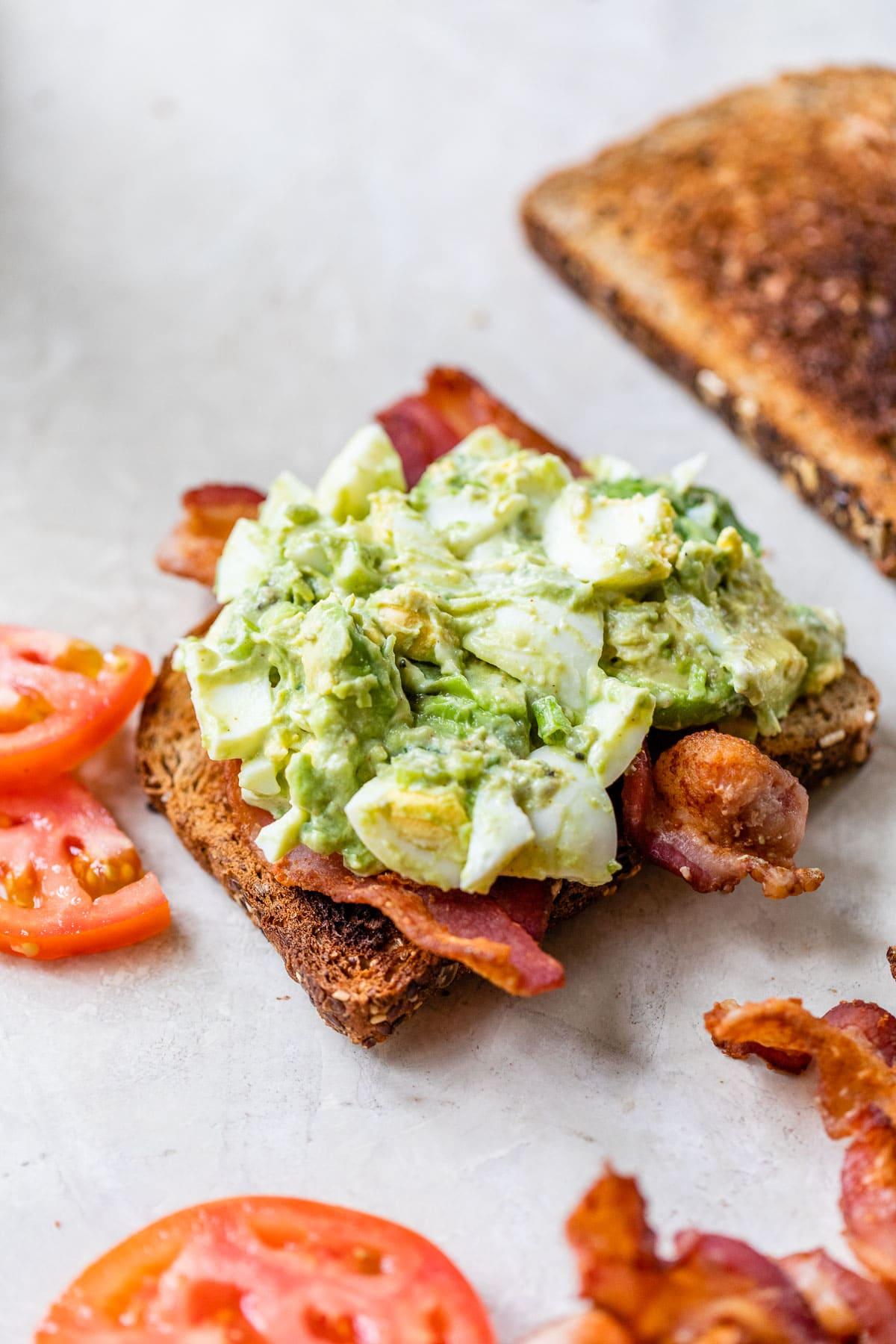 open faced avocado egg salad sandwich