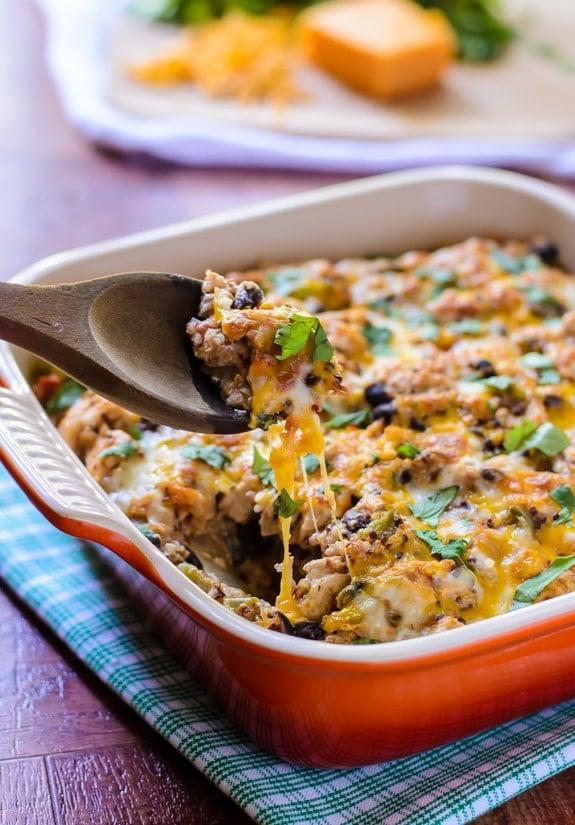Cheesy Mexican Chicken Quinoa Casserole. Healthy, easy and tastes just like a Chipotle burrito bowl!
