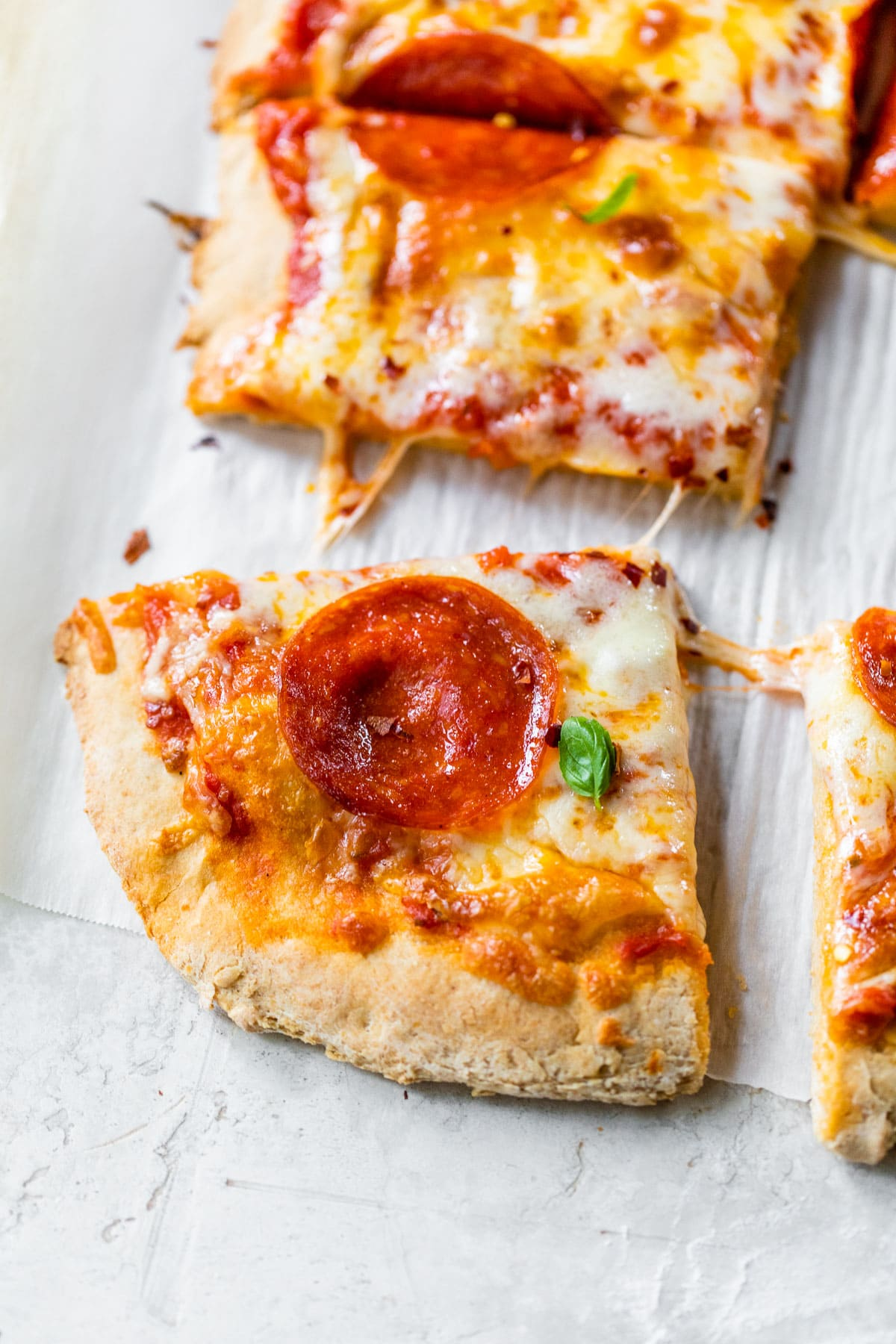 Slice of pepperoni pizza made with homemade whole wheat pizza dough