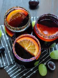Halloween Sangria. Blood red sangria with frozen grape eyeballs. Perfect Halloween drink for a party!