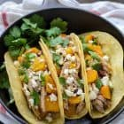 Slow Cooker Pork Tacos with butternut squash served in a cast iron skillet