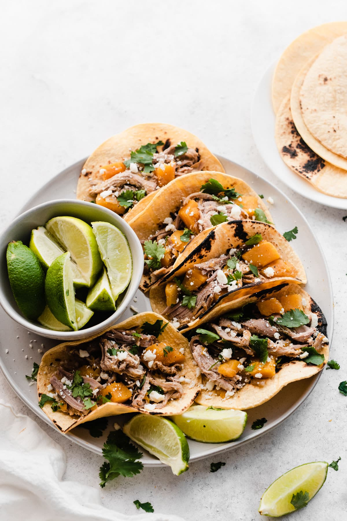 Slow Cooker Butternut Squash and Pulled Pork Tacos. Our entire family loved these!