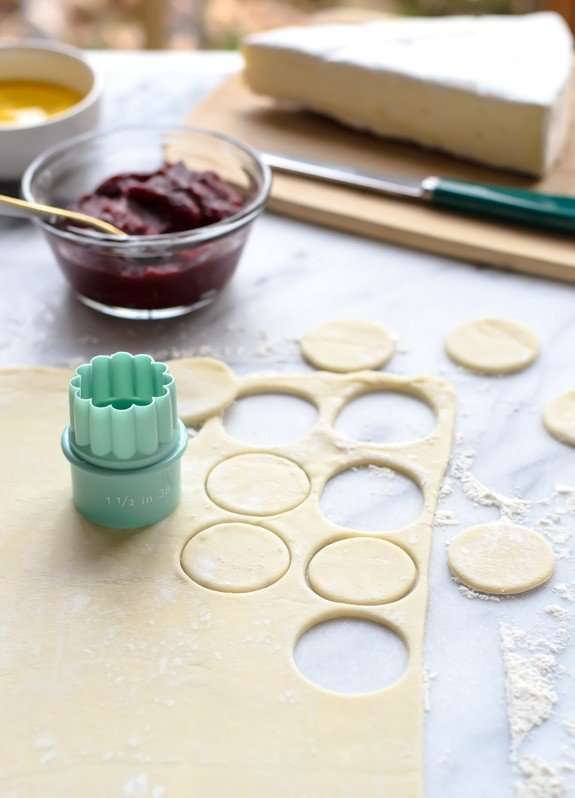 Mini Baked Brie in Puff Pastry- Use a biscuit cutter to cut puff pastry rounds, then fill with cranberry and Brie