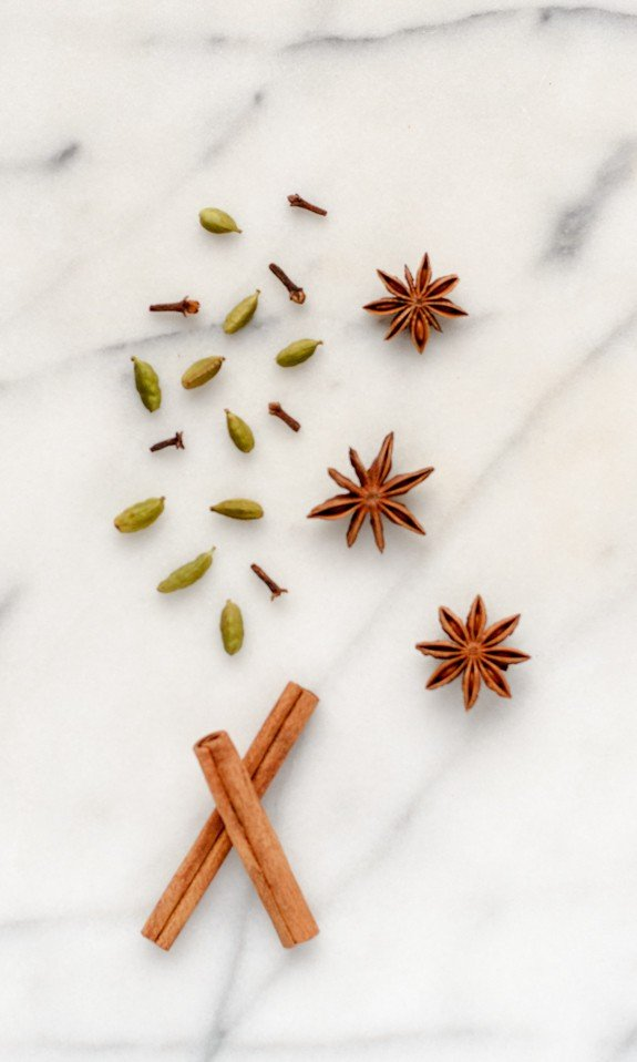 Star anise, cinnamon sticks, clove, and cardamom pods, all ready for making Easy Spiced Wine in a slow cooker