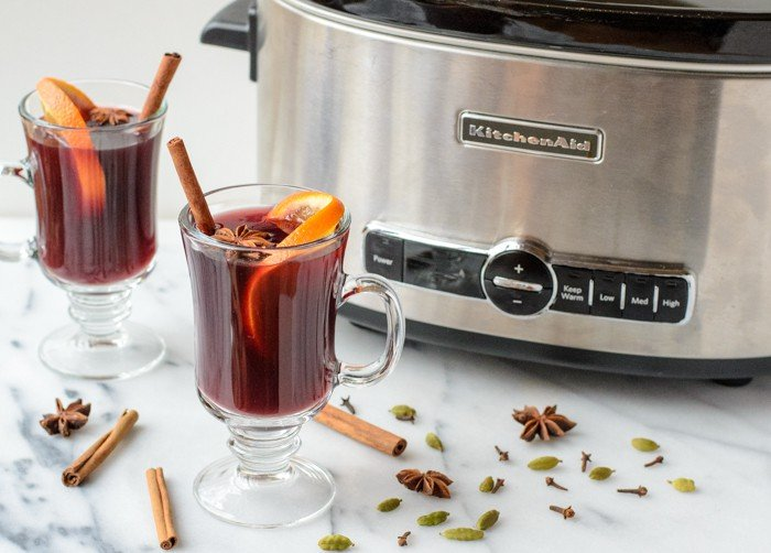 2 mugs of mulled wine made in a slow cooker