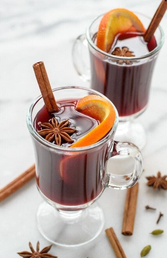 2 clear coffee mugs of Slow Cooker Spiced Wine
