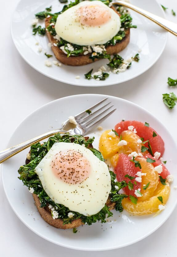 For a fast and healthy dinner, make this Kale Feta Egg Toast. Sauteed greens with creamy feta on toast, topped with a runny egg. DELICIOUS