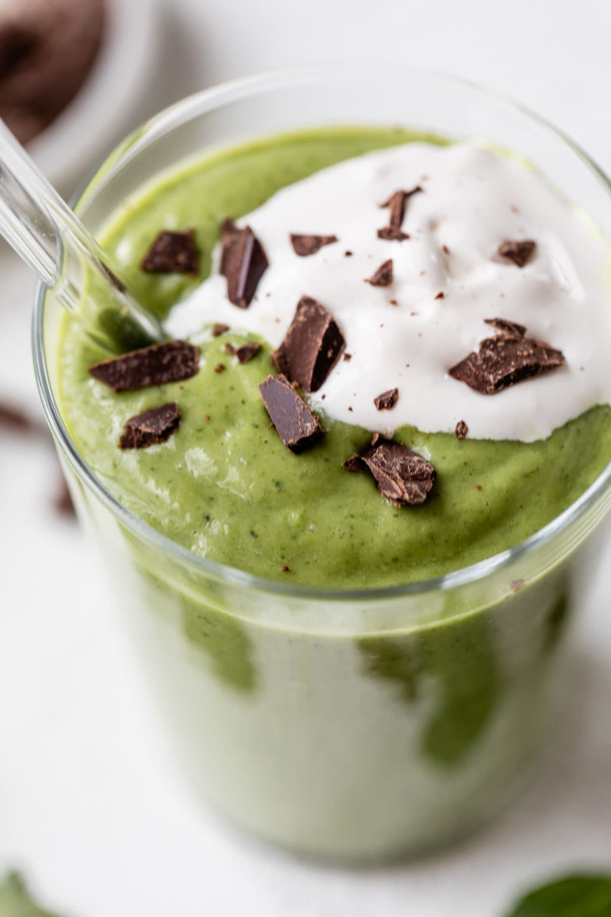 Skinny Shamrock Shakes made with frozen bananas, avocado, and fresh mint. Enjoy this healthy mint smoothie for dessert or after a work out! Vegan and gluten free