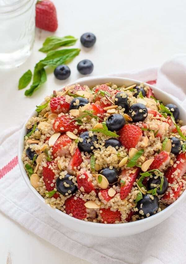 Red White and Blue Quinoa Fruit Salad with Honey Lime Dressing. Perfect for a healthy breakfast or lunch and so festive for Memorial Day or the Fourth of July! {paleo, gluten free}