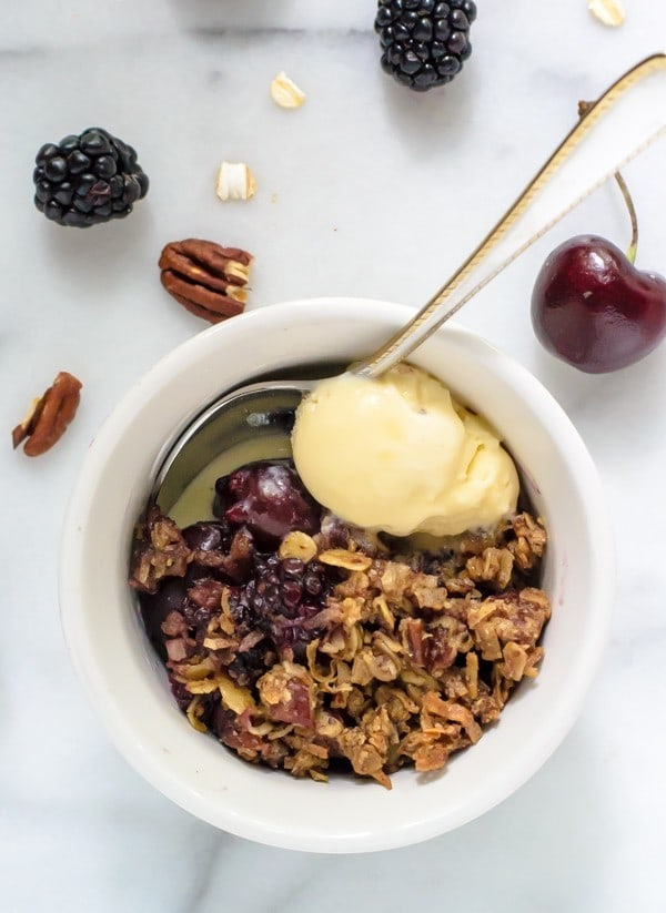Clean Eating Cherry Blackberry Crisp made with wholesome oats, pecans, and maple syrup