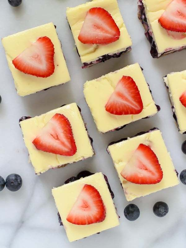 Red White and Blueberry Cheesecake Bars. Easy cheesecake bar recipe that's a perfect Fourth of July dessert!